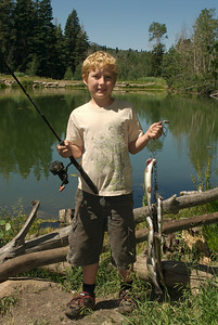 Youth with a string of fish.  Utah Division of Wildlife Resources