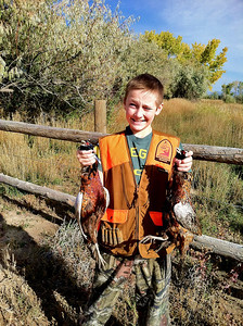 Thomas Morton, age 12, of Eagle Mountain at the 2013 youth pheasant hunt. Photo by Brent Stettler, Utah Division of Wildlife Resources.