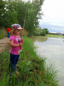 Kayda waits for a bite at the Green River State Park fishing event  9-14-13. Photo by Brent Stettler.