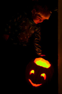 My son Miles admiring a pumpkin at Halloween.