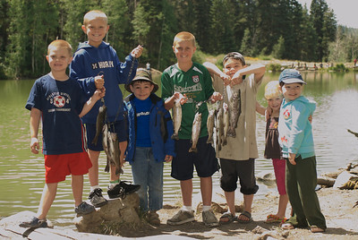 Children showing off the fish they caught.  Photo taken 8-7-09, courtesy of Utah Division of Wildlife Resources.