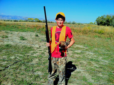 Bryan Marx, age 13, of Price at the 2013 youth pheasant hunt at Desert Lake. Photo by Brent Stettler, Utah Division of Wildlife Resources.