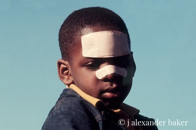 Bandaid Racism,  I tool this in Central Park in NYC about 1970. I like to think that things have changed some since.
