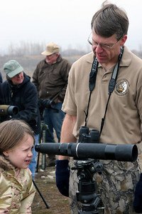 Volunteer Naturalist Brian Currie helps young people see and understand wildlife at Farmington Bay Wildlife Management Area. Photo taken 2-14-06 by Phil Douglass.
