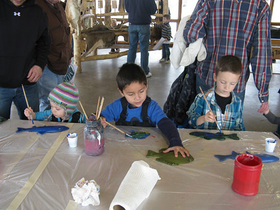 Young kids work on craft projects during Utah's annual Hardware Ranch Elk Festival. Photo taken Dec. 2012, Utah Division of Wildlife Resources.