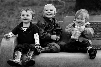 My son Miles and two friends, Grason and Lewis, on a bench.