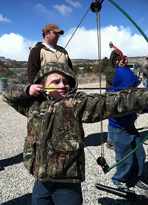 Conner Bulkley of Price at takes aim at the family archery clinic at North Springs Shooting Range. Photo take 3-23-13 by Brent Stettler, Utah Division of Wildlife Resources.