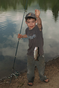 A young boy with a fine catch.  Photo taken 8-8-09 courtesy of Utah Division of Wildlife Resources.