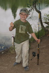 Youth with catch.  Photo taken on 8-8-09 courtesy of Utah Division of Wildlife Resources.
