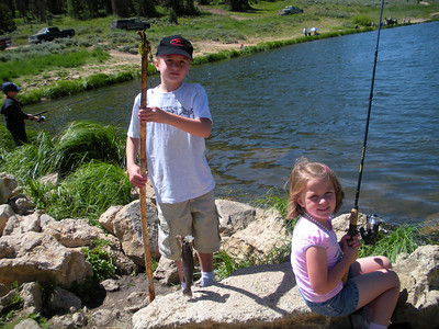 Sam (8) and Caroline (5) Gwilliam catch rainbow trout at Boulger Reservoir.  Photo by Randall Stilson, Utah Division of Wildlife Resources on 7-25-08.