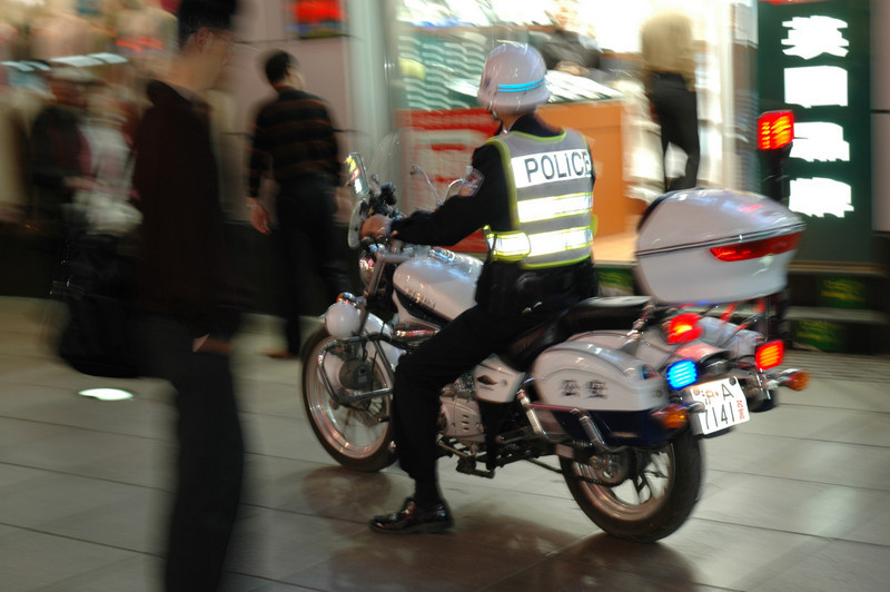 Patrolling the gaudy and expensive pedestrian mall of downtown Shanghai<br /> <br /> ©Gerald Diamond<br /> All rights reserved