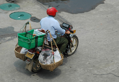 Motorcyclist using his ride as a utility delivery vehicle - Yi Chang, China  ©Gerald Diamond All rights reserved