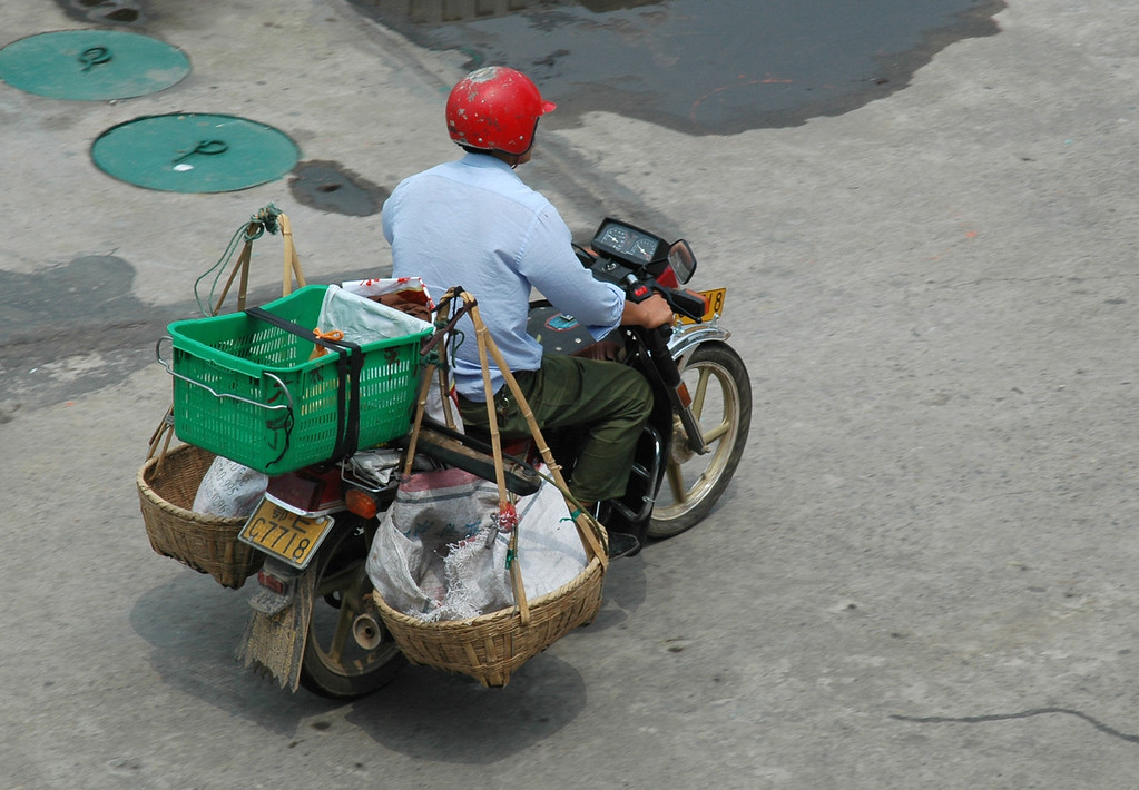 Motorcyclist using his ride as a utility delivery vehicle - Yi Chang, China<br /> <br /> ©Gerald Diamond<br /> All rights reserved