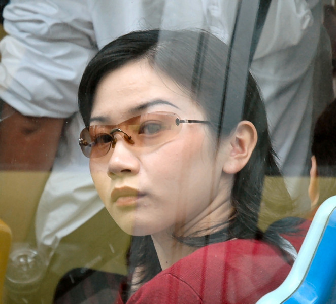 From bus to bus, a close-up of this young woman passing by - Shanghai, China<br /> <br /> ©Gerald Diamond<br /> All rights reserved