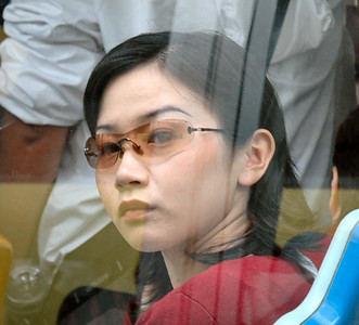 From bus to bus, a close-up of this young woman passing by - Shanghai, China  ©Gerald Diamond All rights reserved