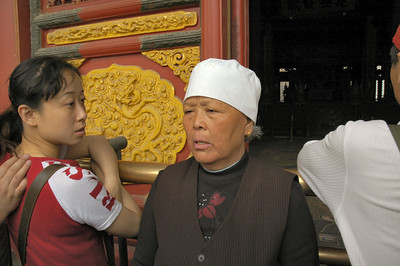 A woman emerging from viewing the Royal Chamber in the Forbidden City - Beijing, China  ©Gerald Diamond All rights reserved