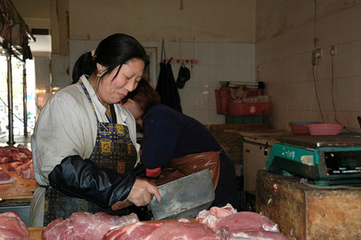 Butcher in Shanghai fresh food market.  ©Gerald Diamond All Rights Reserved
