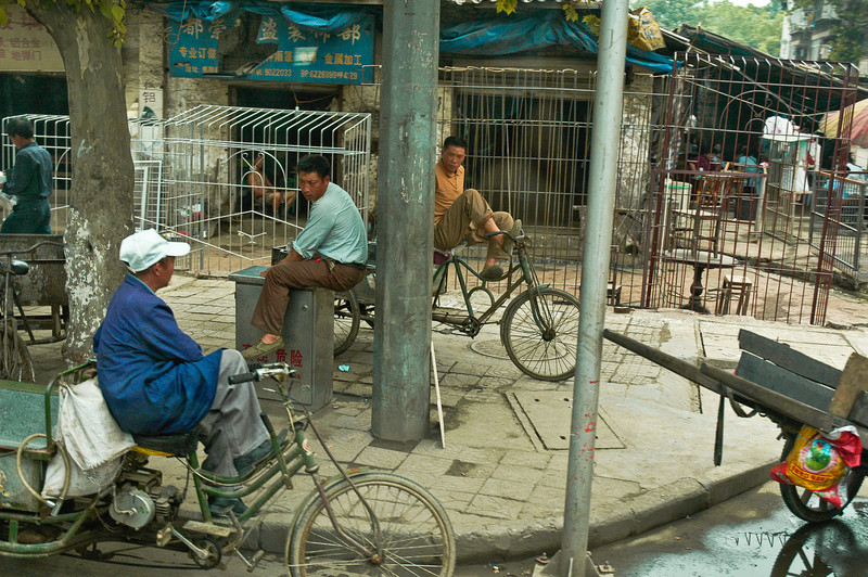 On this humble street corner, spokes and wire frames and conversation easily mix on a quiet afternoon in Yi Chang, China.<br /> <br /> ©Gerald Diamond<br /> All rights reserved