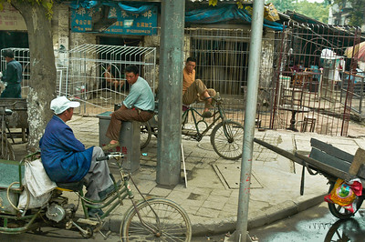 On this humble street corner, spokes and wire frames and conversation easily mix on a quiet afternoon in Yi Chang, China.  ©Gerald Diamond All rights reserved