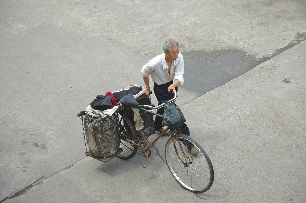 All manner of contraption has been invented to convert bicycles into delivery vehicles - Yi Chang dam downstream on the Yangtze River, China<br /> <br /> ©Gerald Diamond<br /> All rights reserved