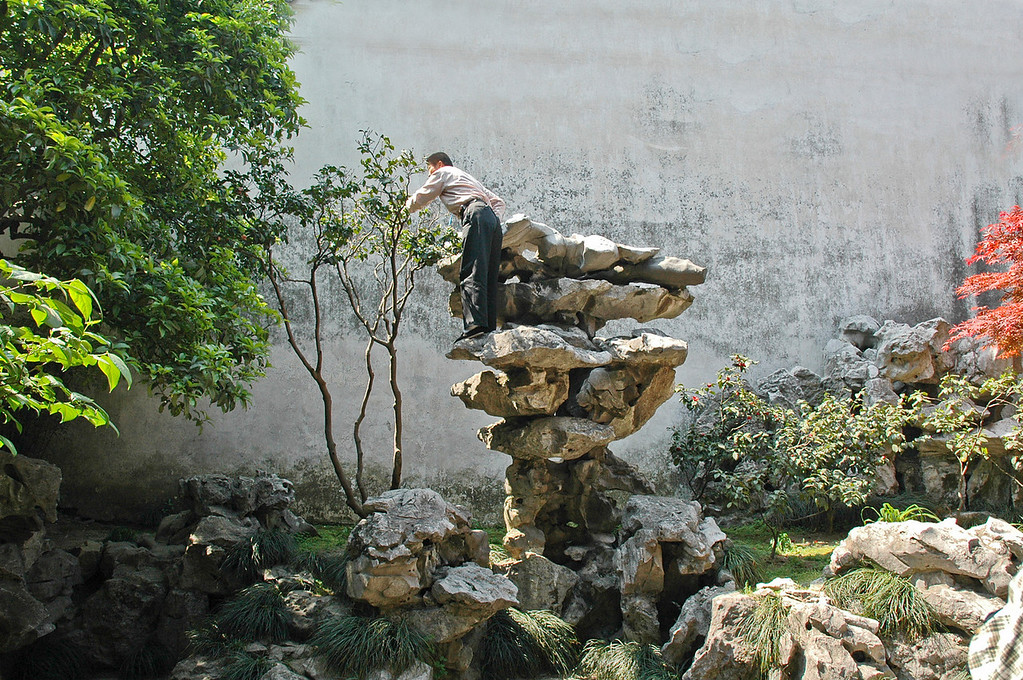 """An attendant pruning a tree in the """"Garden Of The Master Of The Nets"""" in Zhoujiaojiao, south of Shanghai, China.<br /> <br /> ©Gerald Diamond<br /> All rights reserved"""