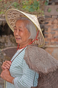a Chinese peasant woman at home