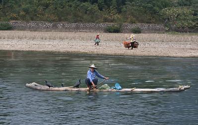 a cormorant fisherman on the Li River, China