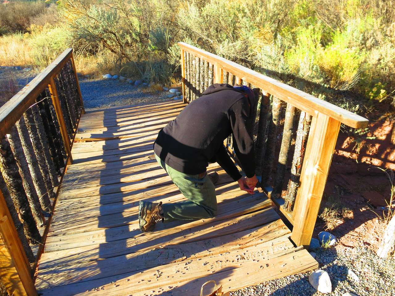 Guests, if they choose to do so, are welcome to take on some work task in the morning - here another guy and I are doing some foot-bridge repairs.