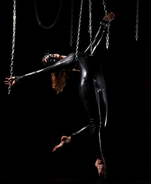 "Adri, an aerial straps artist suspends from chains -  Mask from  <a href=""http://www.masksbymorgan.com"">http://www.masksbymorgan.com</a>"