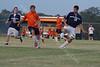 Alumni squares off with senior Zach at Harrison High School alumni soccer game.      July 23, 2011