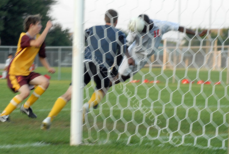 Blurry but a cool pic<br /> West Lafayette Scores on McCutcheon with a header<br /> September 3, 2009<br /> West Lafayette, Indiana<br /> Soccer Field<br /> High School Soccer Game<br /> McCutcheon Mavericks<br /> vs<br /> West Lafayette Red Devils
