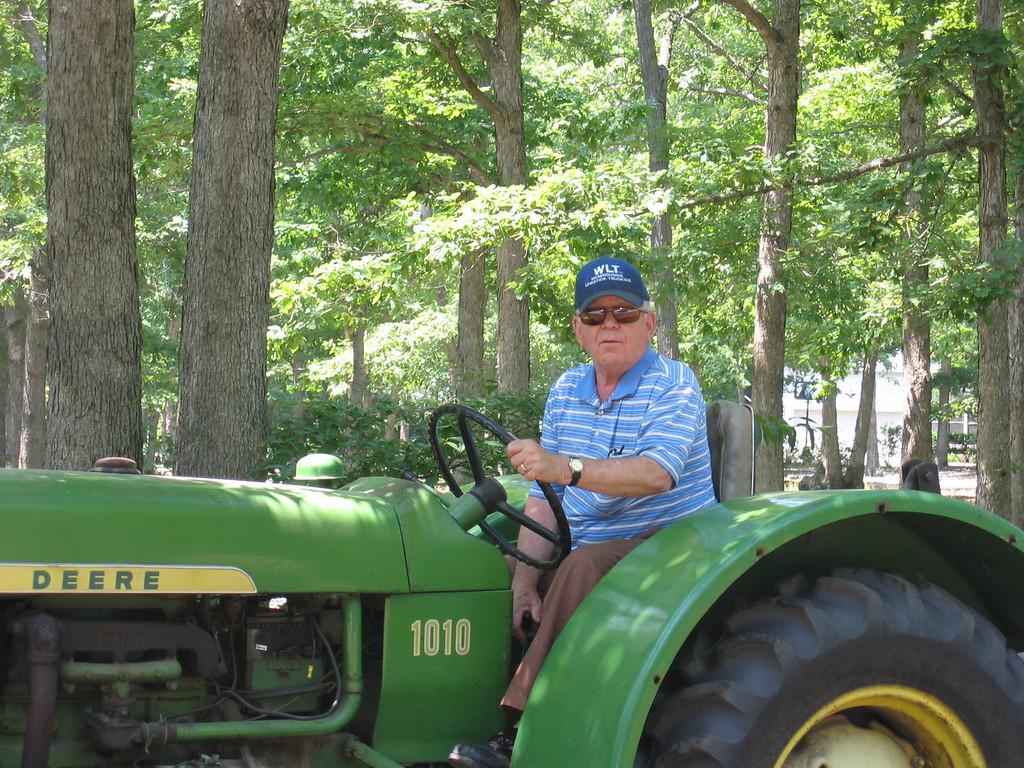 Dad on Grandpops John Deere
