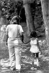 mom & girl walking hand in hand