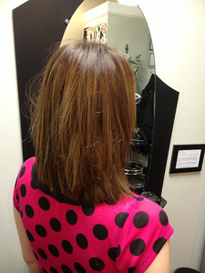 Sunkissed and sublte balayage highlighting. No harsh lines but a gentle over all lightness.