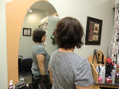 shorter to longer layered cut done completely with razor.
