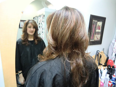 long layered style with highlights of reddish and blonde-copper colors.