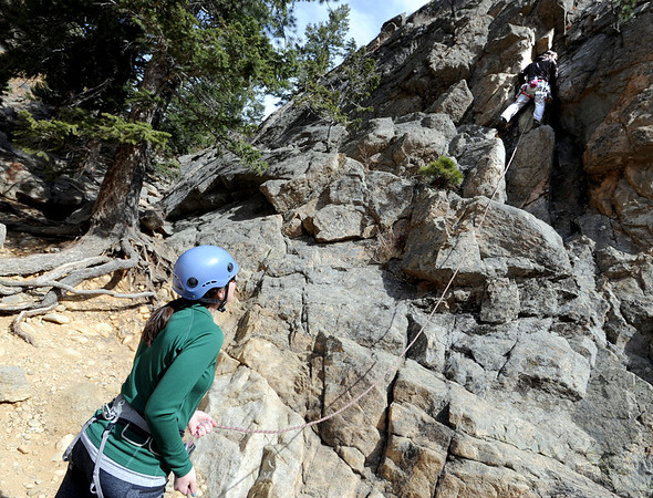"Johanna Prader and Bryce Setta, both relocating to Boulder from New York,make their first climb at Castle Rock on Sunday.<br /> For more than 50 years, no one has done any maintenance to the pullout loop by Castle Rock in Boulder Canyon. That's because land management agencies all thought it was the other guys' problem. Turns out, its Boulder County's problem ( in part), so now the open space department is proposing some upgrades to the area.<br /> For more photos of climbing, go to  <a href=""http://www.dailycamera.com"">http://www.dailycamera.com</a>.<br /> Cliff Grassmick / March 18, 2012"