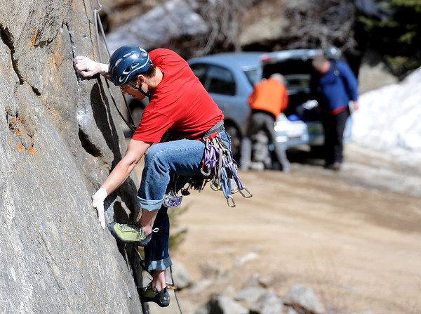 """Adam Brink climbs up one of the routes at Castle Rock Sunday afternoon.<br /> For more than 50 years, no one has done any maintenance to the pullout loop by Castle Rock in Boulder Canyon. That's because land management agencies all thought it was the other guys' problem. Turns out, its Boulder County's problem ( in part), so now the open space department is proposing some upgrades to the area.<br /> For more photos of climbing, go to  <a href=""""http://www.dailycamera.com"""">http://www.dailycamera.com</a>.<br /> Cliff Grassmick / March 18, 2012"""