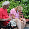 Features around Mirror Lake in Coggshall Park in Fitchburg. Edwina Roddy of Leominster works on an old crossword puzzle book, sitting with her husband John Roddy at Mirror Lake. (SUN/Julia Malakie)