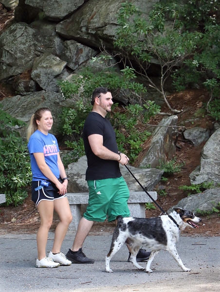 Features around Mirror Lake in Coggshall Park in Fitchburg. Elisabeth and husband Mike Wade of Fitchburg walk their four-year-old Australian shepherd/blue heeler, Zeus.  (SUN/Julia Malakie)