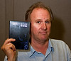 Peter Davison of Doctor Who Fame Holds a 'Night is Day' DVD