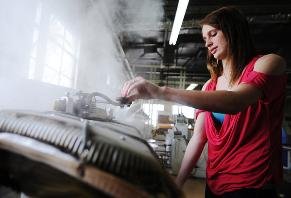 Globe/T. Rob Brown<br /> Sophomore April Gregory, of Harrison, Ark., steams clothing in the Alumni Laundry building at College of the Ozarks in Point Lookout, near Branson.