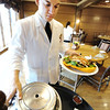 Globe/T. Rob Brown<br /> Senior Ruben De La Rosa, of Pleasant Hill, delivers an order to customers at Dobyns Dining Room in the Keeter Center at College of the Ozarks in Point Lookout, near Branson. De La Rosa is a student manager for Dobyns.