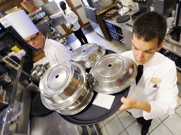 Globe/T. Rob Brown<br /> Senior Ruben De La Rosa, of Pleasant Hill, carries an order from the kitchen of Dobyns Dining Room in the Keeter Center at College of the Ozarks in Point Lookout, near Branson. De La Rosa is a student manager for Dobyns.
