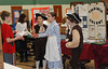 "Fifth-graders from Evergreen Elementary School in Collegeville acted as travel agents for the New World during the school's eighth annual Colonial Expo representing the 13 English colonies. Visitors were greeted by the student travel agents who encouraged the ""potential colonists"" to book a trip for passage to their colony. Students also created colorful visual displays and pamphlets, dressed in colonial garb and displayed items that were relevant to the colony's economy such as peaches, cotton and rice <br /> <br /> Kevin Beattie, Emily Hinz, and Dillon VanGilder try to ""sell"" one of their fellow students on the benefits of living in Virginia.<br /> <br /> Submitted by Perk Valley School District"