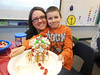 The second grade students at Schwenksville Elementary School in the Perkiomen Valley School District enjoy learning about winter holidays celebrated around the world.  Originally a German tradition, the second graders all participated and made their own gingerbread houses. <br /> Pictured is Malachi Engle with his mother.<br /> <br /> Submitted by Swenksville Elementary School