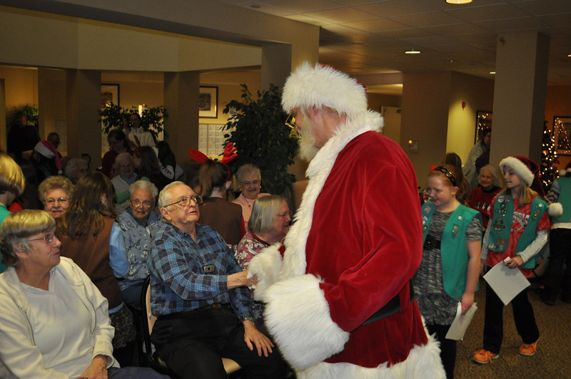 Two Girl Scout troops from St. John's Lutheran Church in Boyertown, Brownie Troop #1759 and Junior Troop #1854, visited Walnut Woods Independent Senior Living Community  in Boyertown, in December to sing Christmas Carols and wish the residents a merry Christmas.  Mr. and Mrs. Claus accompanied the girls who are in second through fifth grades.<br /> <br /> Submitted photos