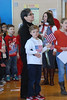 Students at South Elementary School in Trappe waved American flags, sang patriotic songs and learned about what it means to be a citizen during a special surprise ceremony held to honor Lety Ojesto, a teaching assistant who was recently granted U.S. citizenship.<br />   <br /> Lety Ojesto with student Aaron Seeger<br /> <br /> Submitted by Perkiomen Valley School District