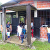 "Locals at El Crucero arrived little by little at the little school, where a meeting is being held by the community to create its own Community Council ""El Porvenir"". This is a requirement this community of Afro-Colombians must meet before they can apply for a land title in the area where they have lived for generations."