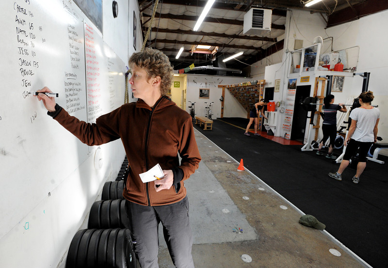 "Connie Sciolino, of the Alpine Training Center, records numbers from her students' workouts.<br /> For more photos and a video, go to  <a href=""http://www.dailycamera.com"">http://www.dailycamera.com</a>.<br /> Cliff Grassmick  / January 2, 2013"